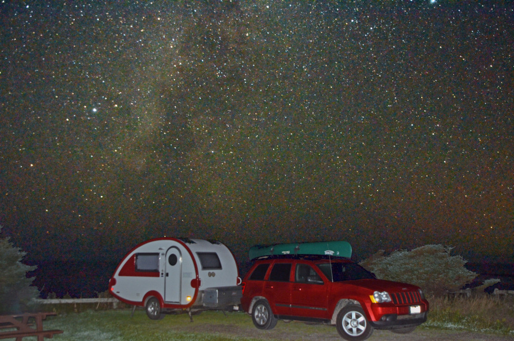 Green Point campground at Gros Morne National Park in Newfoundland Canada. This is the combination of two shots from a tripod. One a long exposure to get the night sky, the other a flash to get the trailer. 2