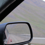 "Looking back in the passenger side mirror at the ""guard rail""."